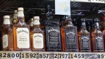 "This July 9, 2018 photo shows bottles of Jack Daniel's liqueur and whiskey displayed at Rossi's Deli in San Francisco. China's government vowed Wednesday, July 11, to take ""firm and forceful measures"" as the U.S. threatened to expand tariffs to thousands of Chinese imports. After the U.S. imposed 25 percent tariffs on $34 billion worth of Chinese goods, China retaliated by imposing tariffs on the same amount of U.S. products including whiskey. (AP Photo/Jeff Chiu)"