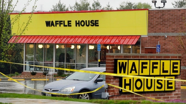 Police tape blocks off a Waffle House restaurant Sunday, April 22, 2018, in Nashville, Tenn. At least four people died after a gunman opened fire at the restaurant early Sunday.(AP Photo/Mark Humphrey)