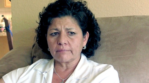 FILE - In this July 14, 2015, file photo from video, Tina Cordova talks of her late father, Anastacio Cordova, in her Albuquerque home. Cordova believes her father, who died in 2013 after suffering from multiple bouts of cancer, was affected by the atomic bomb Trinity Test in New Mexico since he lived in nearby Tularosa, N.M. as a child. The National Cancer Institute says its long-anticipated study into the cancer risks of New Mexico residents living near the site of the world's first atomic bomb test likely will be published in 2019. (AP Photo/Russell Contreras, File)