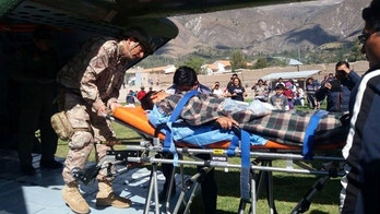 A person is transported to a helicopter after eating contaminated food at a funeral in the Peruvian Andes, authorities said on Tuesday, in Ayacucho, Peru, in this undated photo released August 7, 2018. Courtesy of Agencia Andina/Diresa Ayacucho/Handout via REUTERS   ATTENTION EDITORS - THIS IMAGE WAS PROVIDED BY A THIRD PARTY. - RC1E6FAC67F0