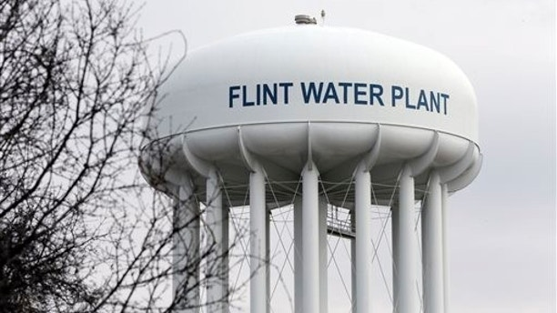 FILE - This Feb. 5, 2016 file photo shows the Flint Water Plant tower in Flint, Mich.  Michigan, seeking to prevent another oversight fiasco after lead poisoning in Flint and a deadly Legionnaires' disease outbreak in the area, is considering new water testing rules for hospitals and possible changes to how large facilities manage their water systems that could include new monitoring requirements. (AP Photo/Carlos Osorio, File)
