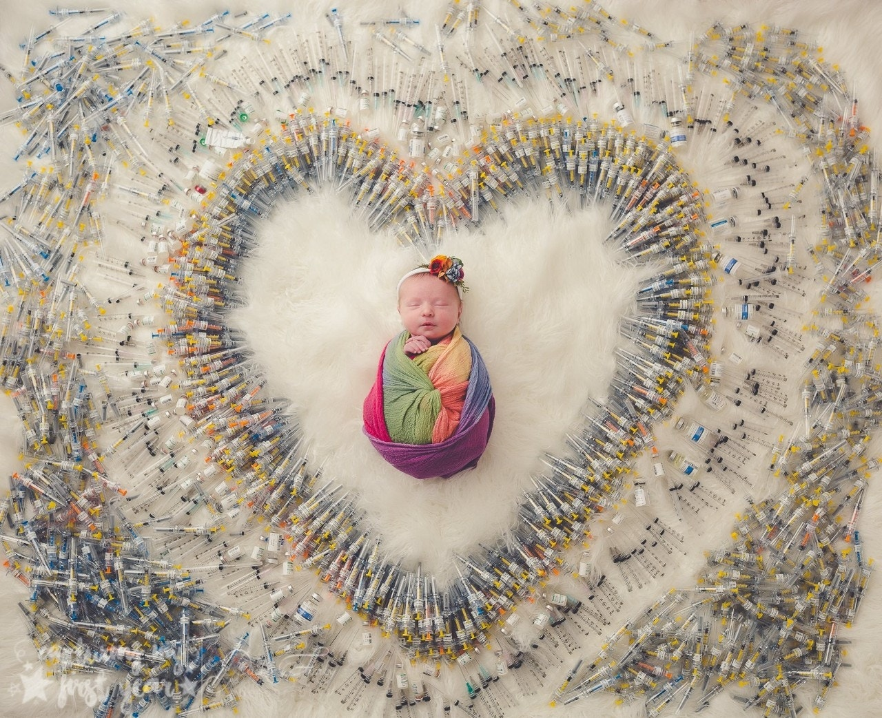 Photo of newborn surrounded by IVF syringes goes viral