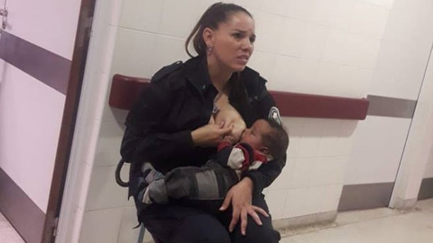 """Celeste Ayala, a police officer in Argentina is being called """"beautiful"""" for breastfeeding a malnourished baby while working at a children's hospital."""