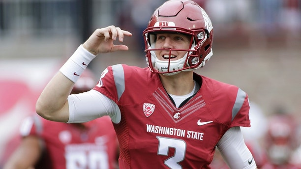 FILE - In this Sept. 17, 2016, file photo, Washington State quarterback Tyler Hilinski (3) runs onto the field with his teammates before an NCAA college football game against Idaho, in Pullman, Wash. Mark and Kym Hilinski keenly remember the swirl of activity. Rushing to Pullman after learning their son, Tyler, had taken his life. Planning memorial services both on the Washington State campus and back home in Southern California. Dealing with authorities as they tried to determine why 21-year-old Tyler was gone. The Hilinskis could have been overwhelmed by the grief and sadness. Then the letters and boxes began arriving at their home, sent by Cougars players, fans and others, saying how much they had been touched by Tyler's story. (AP Photo/Young Kwak, File)