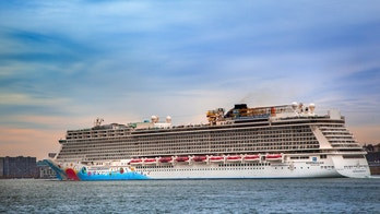 New York City, New York, USA  - November 16, 2014:  Norwegian cruise ship, Breakaway, leaving New York Harbor.  Norwegian Breakaway is home ported at the New York Passenger Ship Terminal in Manhattan and was launched in 2013.