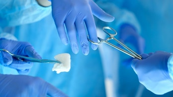 Surgeons hands holding and passing surgical instrument to other doctor while operating patient. Resuscitation medicine team holding steel medical tools saving patient. Surgery and emergency concept