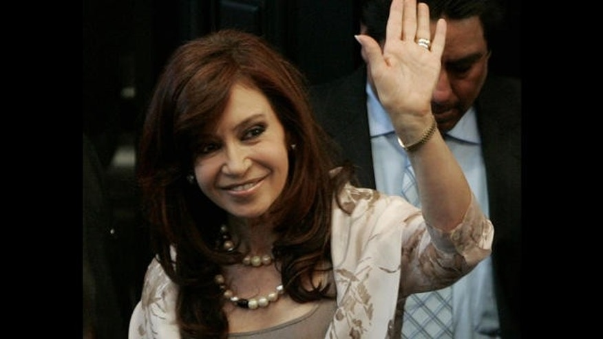 Argentina's first lady and presidential candidate, Cristina Fernandez de Kirchner waves during her visit to Mexico's Senate in Mexico City, Monday, July 31, 2007. (AP Photo/Eduardo Verdugo)