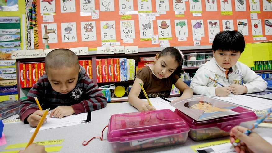 In this photo made Tuesday, Feb. 15, 2011, five-year-old kindergarden students Gael Alvarado, left, Perla Ortiz, center, and Yahir Perez do school work in a bilingual english-spanish class at Hanby Elementary School in Mesquite, Texas. Mesquite ISD, like many districts in Texas, has seen a demographic shift in the racial make up students over the past 10 years. Hispanics account for two-thirds of Texas' growth over the past decade and now make up 38 percent of the state's total population, according to new local U.S. Census figures released Thursday, Feb. 17, 2011. (AP Photo/LM Otero) (AP Photo/LM Otero)