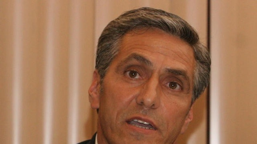 Hazleton Mayor Lou Barletta speaks about illegal immigration during the City Council meeting in Hazleton, Pa., Thursday, July 13, 2006. The City Council approved the Illegal Immigration Relief Act, which would would deny licenses to businesses that employ illegal immigrants, fine landlords $1,000 for each illegal immigrant discovered renting their properties, and require city documents to be in English only, at a meeting Thursday night. The 4-to-1 vote came after nearly two hours of passionate debate. (AP Photo/Rick Smith)