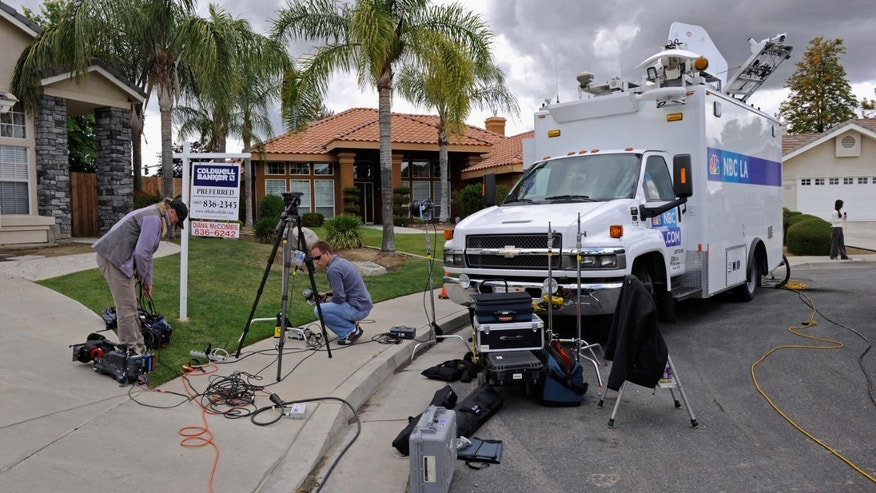 BAKERSFIELD, CA - MAY 18:  News media trucks parked on a residential street wait outside the home of Mildred Patricia Baena, former household staff member who mothered a child with former California Governor Arnold Schwarzenegger, on May 18, 2011 in Bakersfield, California.  (Photo by Kevork Djansezian/Getty Images)
