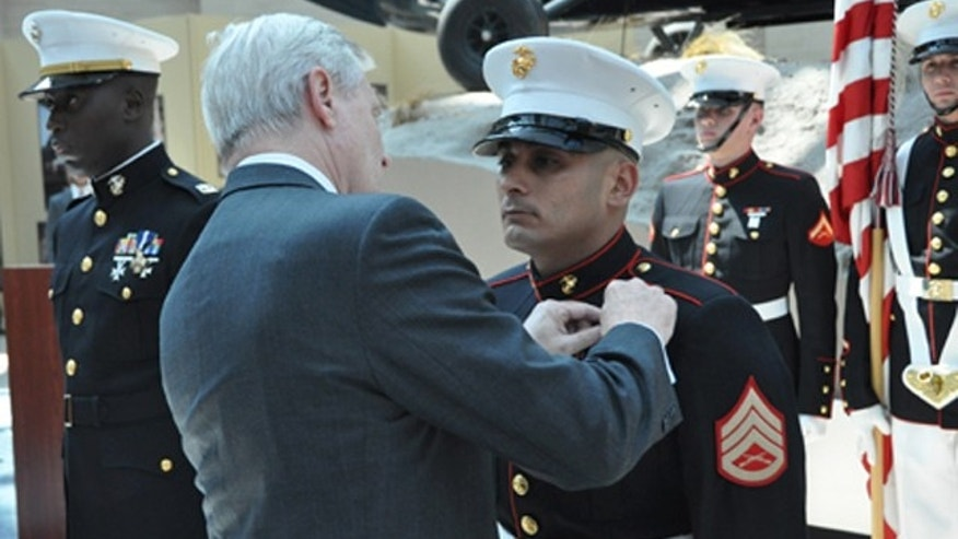 June 10: Secretary of the Navy Ray Mabus presents the Navy Cross to Staff Sgt Juan J. Rodríguez-Chávez shortly after presenting the nationâs second highest award for valor to Capt. Ademola D. Fabayo (left) during a ceremony at the National Museum of the Marine Corps. Photo Credit: Marines