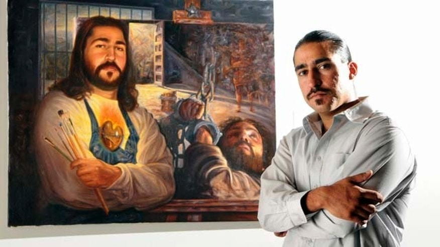In this Tuesday, July 26, 2011 photo, painter Eric Christo Martinez,  poses with one of his paintings that now hangs at the Albuquerque Museum, in Albuquerque, N.M..  (AP Photo/The Albuquerque Journal, Pat Vasquez-Cunningham) THE NEW MEXICAN OUT