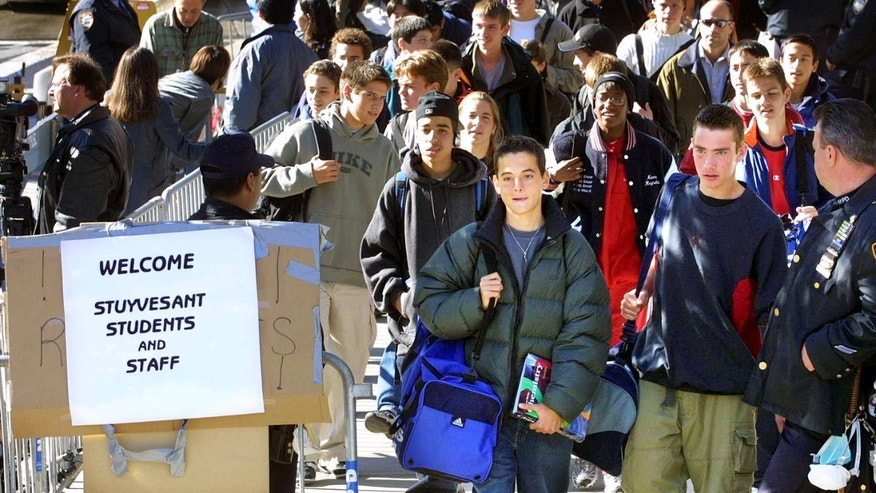 Oct 9, 2001: Students leave Stuyvesant High School at the end of the school day in New York City. The students were allowed to return to the school today for the first time since September 11. (Photo by Mario Tama/Getty Images)