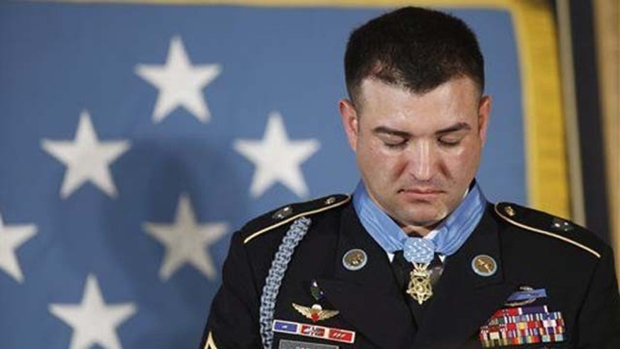 U.S. Army Sgt. First Class Leroy Arthur Petry of Santa Fe, N.M., bows his head in prayer after he was awarded the Medal of Honor by President Barack Obama, for his valor in Afghanistan, Tuesday, July 12, 2011, during a ceremony in the East Room of the White House in Washington, Tuesday, July 12, 2011.