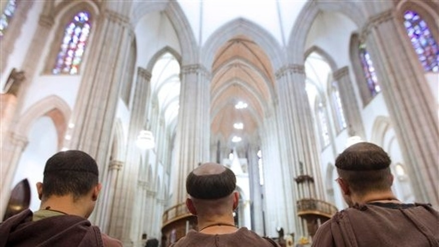 Sept. 5: Monks attend a Mass at the Sao Paulo Metropolitan Cathedral  in Sao Paulo, Brazil.