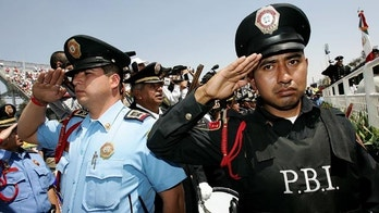 MEXICO CITY - MARCH 05:  Police members salute during the Mexican National Anthem during the NASCAR Busch Series Telcel-Motorola 200 on March 5. 2006 at Autodromo Hermanos Rodriguez in Mexico City, Mexico.  (Photo by Jonathan Ferrey/Getty Images)