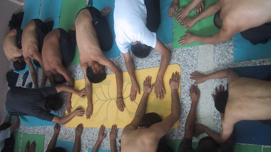 Young men in a Mexico City juvenile detention center practice yoga as part of a new program.