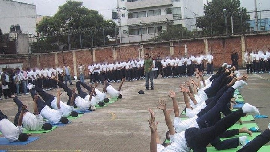 Young men in a Mexico City juvenile detention center demonstrate the yoga they learned.