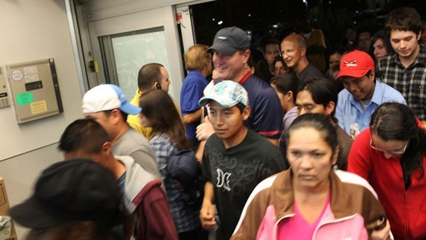 NAPLES, FL - NOVEMBER 26: Shoppers crowd a Best Buy store at dawn during Black Friday, the day after Thanksgiving which commences the holiday gift-buying season on November 26, 2010 in Naples, Florida. That scene is expected to play out all at shopping centers across the country on November 25, 2011. (Photo by Spencer Platt/Getty Images)