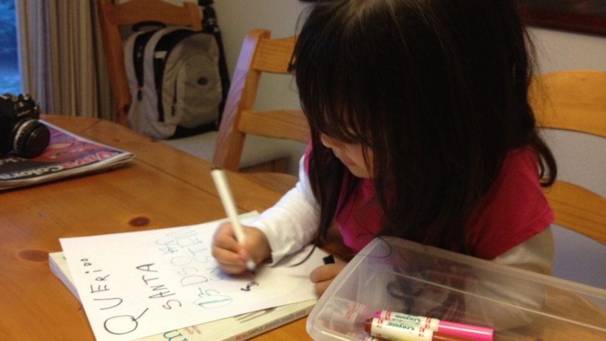 My 5-year-old daughter writing a letter to Santa.