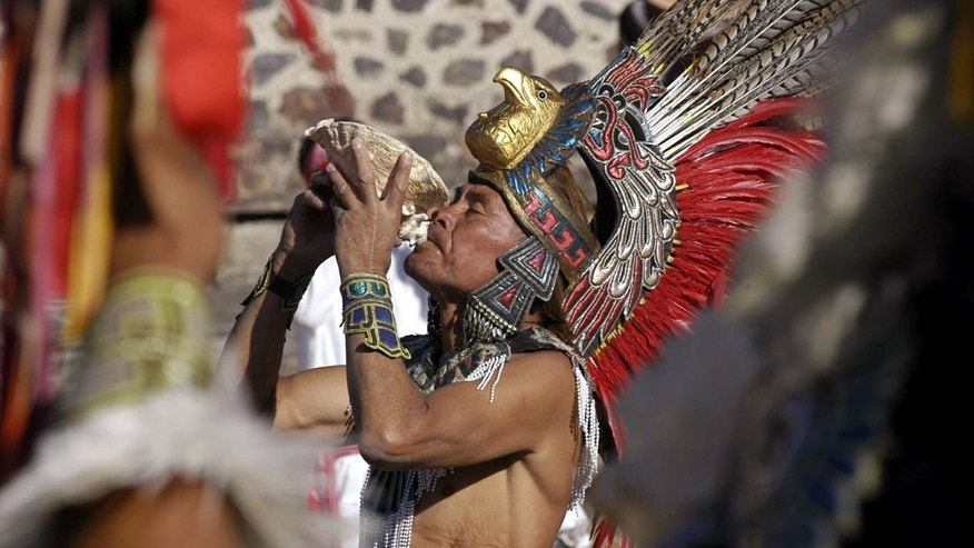 MARCH 21:  A traditional Teotihuacan dancer performs in front of a pyramid during spring equinox rituals March 21, 2003 at the ruins of the pre-Hispanic city of Teotihuacan, Mexico. (Photo by Susana Gonzalez/Getty Images)