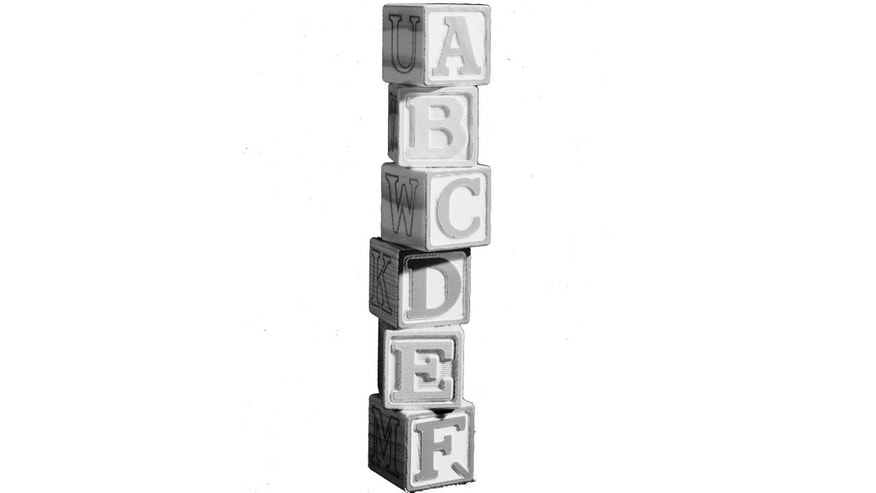 17th July 1962:  A wobbly tower of building blocks with the letters of the alphabet on them.  Marlon House.  (Photo by Chaloner Woods/Getty Images)