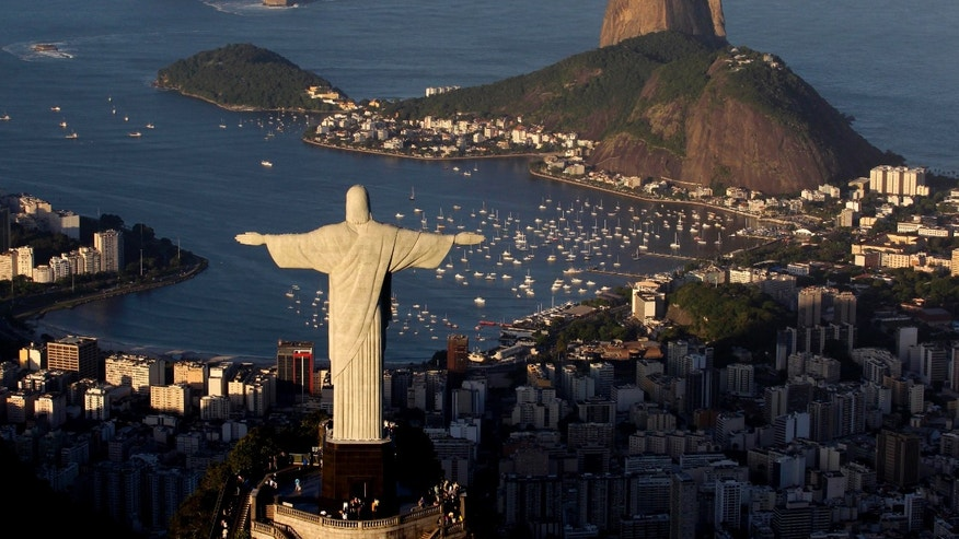 FILE -  In this May 30, 2011 file photo, the statue of Christ the Redeemer is seen with the Sugar Loaf mountain at back in Rio de Janeiro, Brazil.   That idea of putting up a giant Jesus statue in a London park is not going over well. Brazil's tourist board floated the notion of erecting a 30-foot (9-meter) replica of Rio de Janeiro's Christ the Redeemer statue a symbol of peace and a well-known landmark of the city. The idea would be to promote the 2016 Olympics in Rio. (AP Photo/Felipe Dana, File)