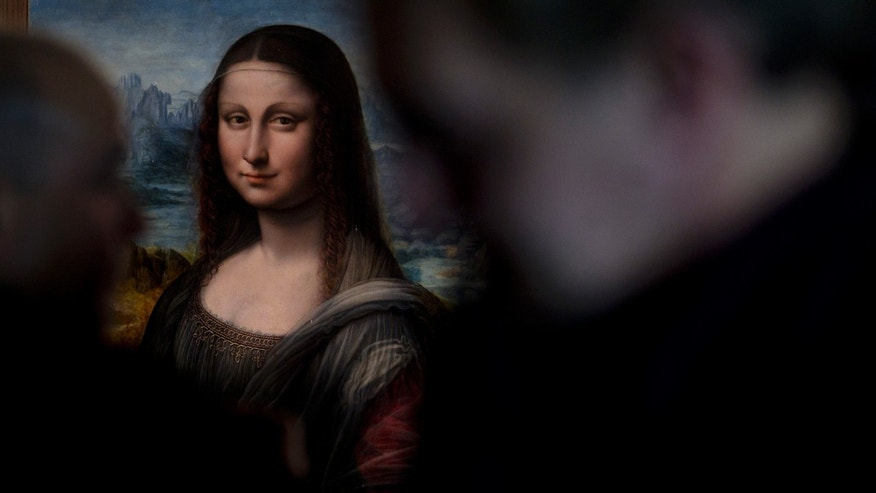 A copy of Leonardo da Vinci's Mona Lisa that was painted at the same time as the original in the same studio is displayed at the Prado Museum in Madrid Wednesday Feb. 1, 2012. Spain's Prado Museum says the copy it has of Leonardo da Vinci's Mona Lisa was painted at the same time as the original perhaps making it the earliest replica of the masterpiece. A museum spokeswoman said the work was painted side by side with the 16th century original that hangs in the Louvre in Paris and was done by one of Leonard's key students. (AP Photo/Paul White)