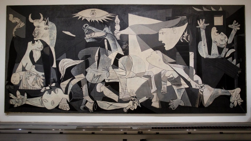 "This  Tuesday Feb. 21, 2012 photo of Pablo Picasso's ""Guernica"" painting is seen displayed at the Reina Sofia Museum in Madrid. (AP Photo/Paul White)"