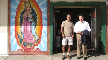 Eduardo Figueroa, right, with a new business owner.