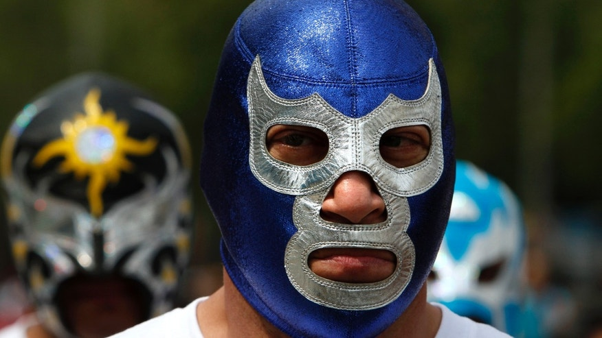 Mexican Lucha Libre wrestler Blue Demon Jr. leads a march for peace in downtown Mexico City, Sunday March 18, 2012.  (AP Photo/Marco Ugarte)
