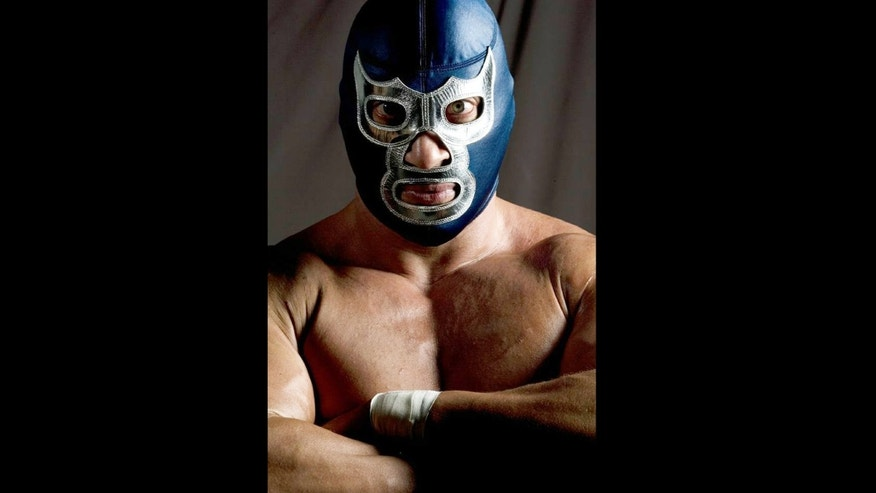 "This undated image provided by Lucha Libre USA shows ""Blue Demon, Jr."", a popular Mexican wrestler who says he's a defender of immigrants and US Latinos. As more promotions of Lucha Libre, aka, Mexican-style wrestling, expands into U.S. and targets growing Mexican immigrant and Mexican American markets, they are beginning to adopt more political tones and tap into strong sentiments over immigration to draw an audience.(AP Photo/Lucha Libre USA)"