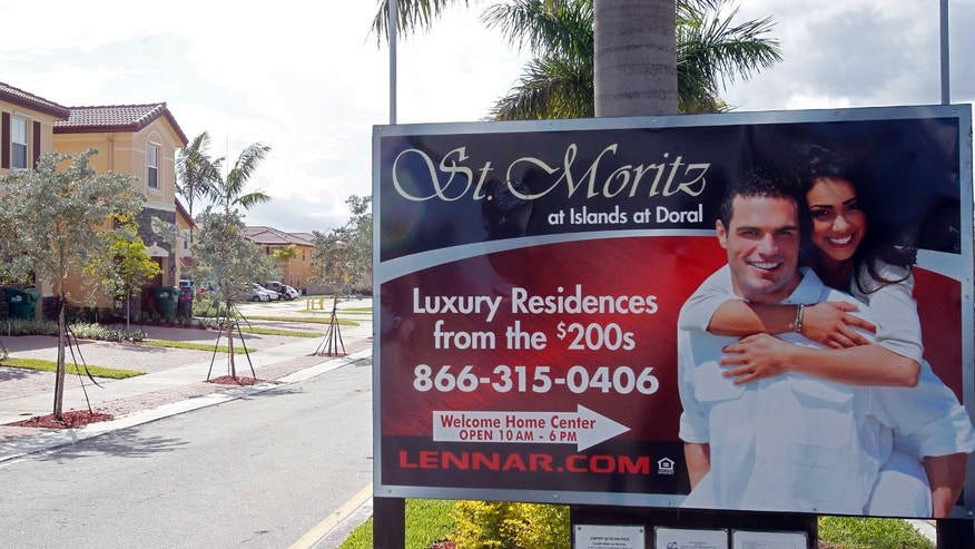 This March 16, 2012, shows a sign for new homes for sale in Doral, Fla. Homebuilders' feelings about the current housing market haven't changed from February. But many are growing more optimistic that sales could pick up in the coming months. (AP Photo/Alan Diaz)
