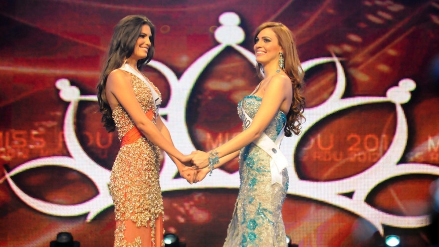 April 17: Carlina Duran, left, and Dulcita Lieggi stand together as they compete in the Miss Dominican Republic beauty pageant in Santo Domingo, Dominican Republic.