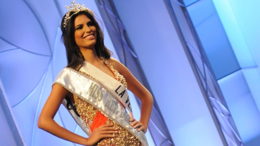 In this April 17, 2012 photo, Carlina Duran wears her crown and sash after winning the Miss Dominican Republic beauty pageant in Santo Domingo, Dominican Republic. Duran lost her crown due to the discovery that she wed in 2009.  Miss Dominican Republic Director Magaly Febles says contestants must be single.  (AP Photo/Victor Calvo)