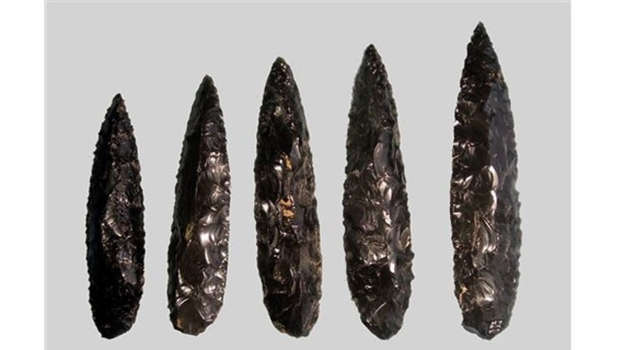 In this undated image released by Mexico's National Institute of History and Anthropology, INAH, sharp obsidian knives found in Cantona, in the central Mexico state of Puebla, are displayed for photos.