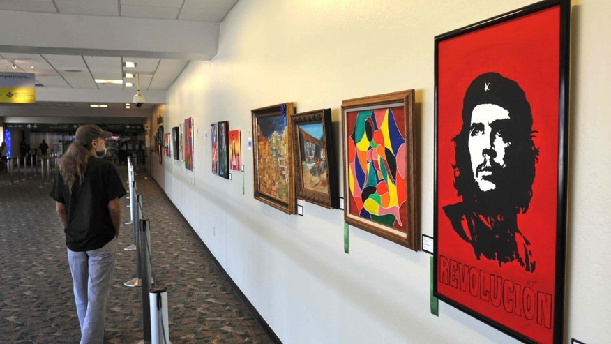 A painting of revolutionary leader Che Guevara by Winston Alamilla is displayed at the Reno-Tahoe International Airport in Reno, Nev.
