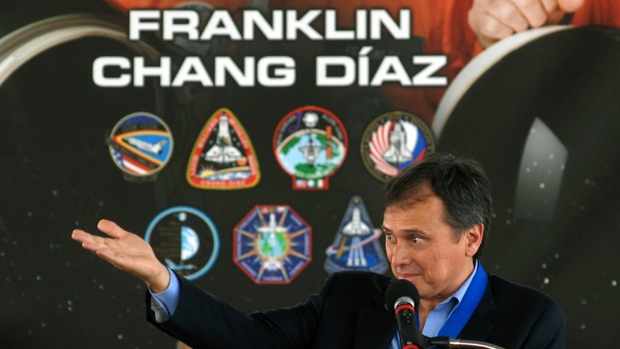 Franklin Chang-Diaz takes the podium after being inducted into the 2012 U.S. Astronaut Hall of Fame, Saturday, May 5, 2012 at the Kennedy Space Center, Fla. Chang-Diaz, NASA's first Hispanic astronaut was among three astronauts  who joined John Glenn, Neil Armstrong and Sally Ride in the U.S. Astronaut Hall of Fame. (AP Photo/Florida Today, Tim Shortt)  NO SALES; MAGS OUT