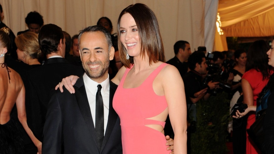 In this May 7, 2012 file photo, Calvin Klein creative director Francisco Costa, left, and actress Emily Blunt arrive at the Metropolitan Museum of Art Costume Institute gala benefit in New York.