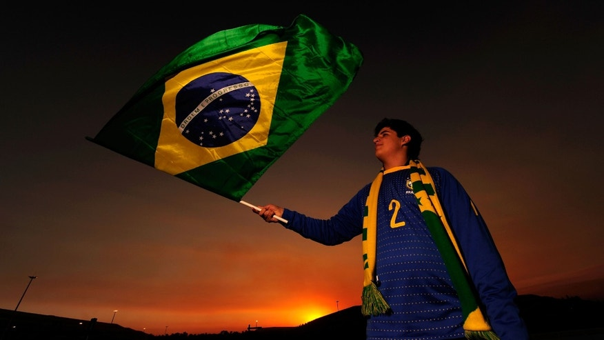 JOHANNESBURG, SOUTH AFRICA - JUNE 20:  A Brazil fan waves her national flag ahead of the 2010 FIFA World Cup South Africa Group G match between Brazil and Ivory Coast at Soccer City Stadium on June 20, 2010 in Johannesburg, South Africa.  (Photo by Stuart Franklin/Getty Images)