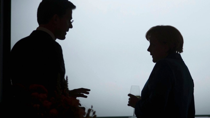 "BERLIN, GERMANY - JUNE 20:  In this photo provided by the German Government Press Office (BPA), German Chancellor Angela Merkel talks with the Dutch Prime Minister Mark Rutte (L) ahead of a working dinner at the Chancellery on June 20, 2012 in Berlin, Germany. Merkel told a joint press conference held with Rutte that while bailout schemes proposed to aid the Eurozone crisis include options to purchase state debt through the secondary bond market, this was not under discussion and was ""purely theoretical"".  (Photo by Guido Bergmann - Pool/Bundesregierung-Pool via Getty Images)"