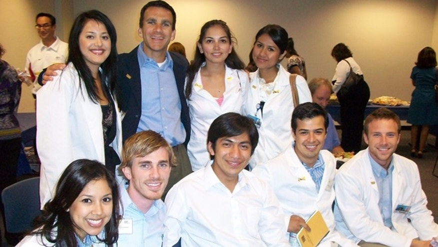 Stephanie Bravo (third in back row left to right) with PRIME program students and mentors.