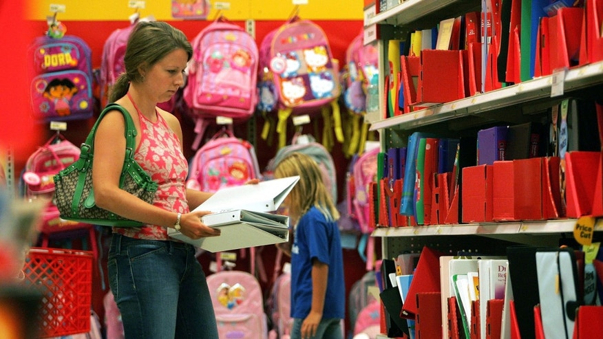ROSEMONT, IL - AUGUST 11:  A woman shops for folders and binders in the back-to-school section of a Target store August 11, 2005 in Rosemont, Illinois. With the start of school nearing, retailers are stocking up in anticipation of back-to-school shoppers.  (Photo by Tim Boyle/Getty Images)