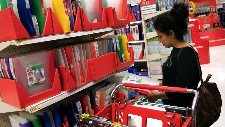 CHICAGO - AUGUST 29: Ada Dildine shops for her three daughters' back-to-school needs in a Target store August 29, 2006 in Chicago, Illinois. Public schools in Chicago are set to open September 5. (Photo by Tim Boyle/Getty Images)