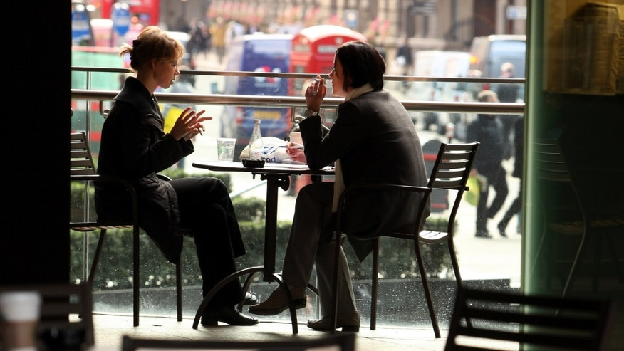 LONDON, ENGLAND - OCTOBER 23:  Two women chat during lunch in a cafe in the City of London on October 23, 2009 in London, England. Coffee consumption and 'cafe culture' in developed countries has dramatically increased in the past forty years. In particular, the cafe company 'Starbucks' has opened over 15,000 stores worldwide since it was founded in 1971.  (Photo by Oli Scarff/Getty Images)