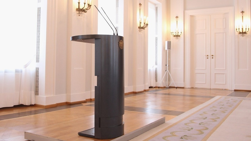 BERLIN, GERMANY - FEBRUARY 17:  The president's speaker's podium stands empty after German President Christian Wulff announced his resignation to the media at Bellevue Palace on February 17, 2012 in Berlin, Germany. Wulff is resigning following the launch of investigations by a state prosecutor into possible illegal benefits Wulff received from businessmen while Wulff was governor of Lower Saxony.  (Photo by Sean Gallup/Getty Images)