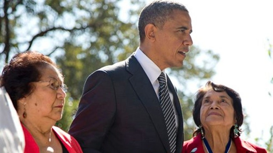 President Barack Obama walks with Cesar Chavez' widow Helen F. Chavez, left, and Dolores Huerta, Co-Founder of the United Farm Workers, as they tour the Cesar E. Chavez National Monument Memorial Garden, Monday, Oct. 8, 2012, in Keene, Calif.
