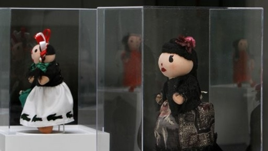 Sept. 9: Traditional Mexican Maria Dolls dressed by French label Kenzo, right, and Lacoste, left, are on display at the Museum of Folk Art in Mexico City. For the first time, Mexico City has joined the global Fashion's Night Out.