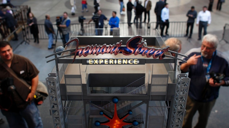 A model of SlotZilla is displayed during a news conference in Las Vegas on Tuesday, Nov. 27, 2012. Officials on Tuesday unveiled plans for SlotZilla, a permanent zip line on the downtown Las Vegas promenade known as the Fremont Street Experience.