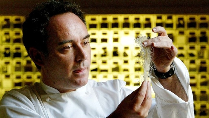 FILE - In this Dec. 5, 2003 file photo, Spanish chef Ferran Adria examines ingredients in his kitchen workshop in Barcelona, Spain. Spainâs famed chef Ferran Adria says the wine cellar of his former restaurant, elBulli is to be auctioned to raise funds for his new project, the elBulli Foundation.  (AP Photo/Bernat Armangue, File)